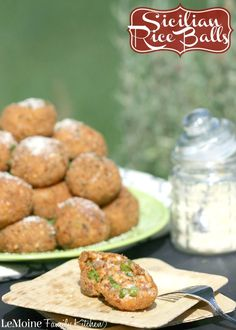 Sicilian Rice Balls :: Italian Street Food | LeMoine Family Kitchen. In Italy these are called Arancini because of the orange color these have. Tender arborio rice with cheese, beef, peas and sauce. Fried until perfectly crisp and golden.