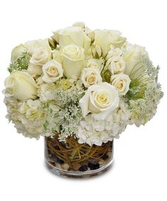Ivory Enchantment - This lovely bouquet is sure to make an impression with its elegant assortment of flowers. #KittelbergerFlorist #RochesterFlowers