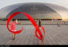 Women practice ribbon dancing at the National Centre for Performing Arts park in Beijing, China © Planetpix / Alamy
