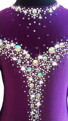 Beautiful competition figure skating dress Made of purple (plum) lycra with mesh sleeves and chiffon skirt Decorated with shiny crystals - 1000 pieces. Very good quality of crystals and shine. This is pre-order item. After receiving cleared payment and confirming all measurements I
