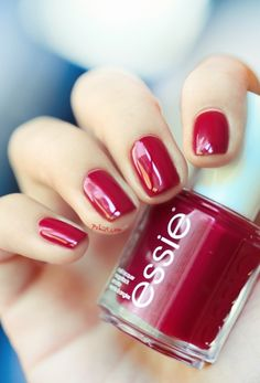 For nails that stand out against your wedding dress, go for Essie's Head Mistress, a deep ruby red.