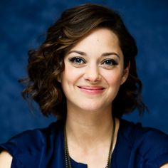 Marion Cotillard's versatile bob: For touchable waves, create a side part, curl hair away from the face with a 1-inch curling iron, then brush through the curls with his fingers to relax them.