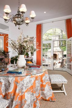 Lush bits of orange were added to L'Orangerie by Kelley Interior Design