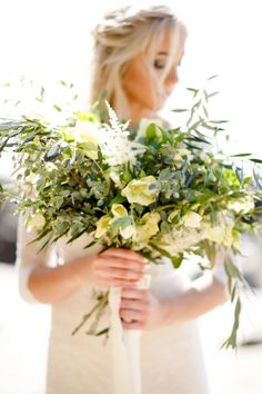 Yellow flowers and lots of olive branches: http://www.stylemepretty.com/2015/05/15/windswept-coastal-bridal-session/ | Photography: Ashlee Raubach - http://www.ashleeraubach.com/