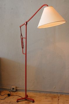 Jacques Adnet; Leather-over-Metal Floor Lamp, c1950.