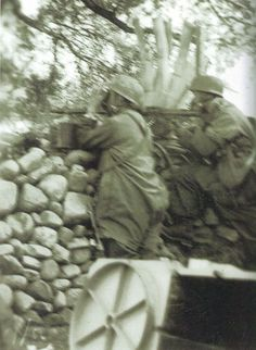 A 3rd Fallschirmjager regiment machine-gun position in the shelter of a small stone wall, near Malemes, Kreta, 20. May. 1941.