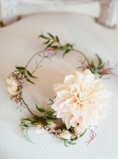 this is cute! You could have the big flower off to side and then more subtle ones around for a crown.  That way you get the best of both worlds :)
