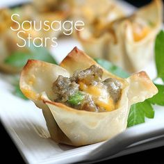 Sausage Stars  2 cups (1 lb.) cooked crumbled sausage  1  1/2 cups grated sharp Cheddar cheese  1 1/2 cups grated Monterey Jack cheese  1 cup Ranch   1 can (2.25 oz) sliced ripe olives  1/2 cup chopped red or green pepper   1 pkg. won ton wrappers