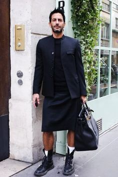 Marc Jacobs in Doc Martens, Kilt and Mao style collar vest....all black