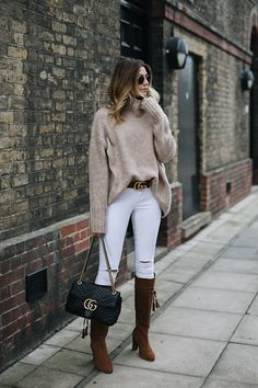 Emma Hill wears beige chunky knit, white skinny jeans, tan GG Gucci Marmont belt, Black leather Gucci Marmont bag medium, tan suede block heel knee high boots, gold frame round Rayban sunglasses, chic winter outfit