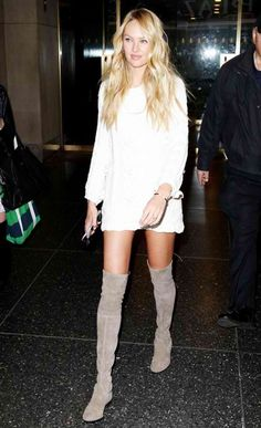 Candice looked so stylish in Stuart Weitzman boots and a mini white dress.