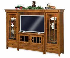 Enjoy watching your favorite TV series within this great Amish Centennial 4 Piece TV Wall Unit with Curio Cabinets & Console.