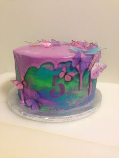 Watercolor drip cake with wafer paper butterflies