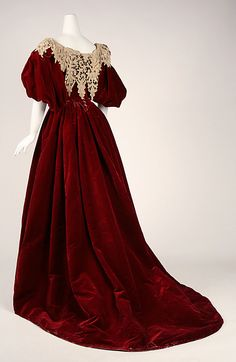 Red silk velvet evening dress (back, with off-the-shoulder bodice with Battenburg lace bertha), by Charles Frederick Worth, French, 1893-95.