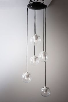 Gino Sarfatti. 2095/5 ceiling light, 1958. H. 160 cm; D. 14 cm. Made by Arteluce, Milan. Sheet metal, painted black, aluminium, clear glass. Marked: Makers label.