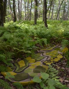 ...how cool would it be to stumble upon these rugs by Angela Adams in a forest?