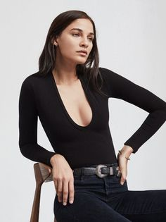 The Gloria Bodysuit is down for whatever. She looks great with jeans, mini skirts, and pretty much any other bottoms you throw at her. This is a medium weight ribbed jersey bodysuit with a deep scoop neckline and long sleeves. The sides are cut higher to make your bum look good. The fabric has some nice stretch, hugs the curves. Made from 88% Tencel / 12% spandex.