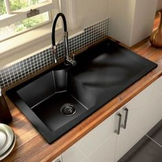 love the idea of a black sink