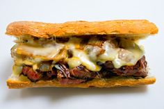 Pat LaFrieda's filet mignon sandwich contains Monterey jack cheese, sweet onions, and is served au jus on a toasted baguette.          http://VIPsAccess.com/luxury/hotel/tickets-package/f1-monaco-grand-prix-yacht-cruise.html