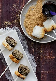 Poppytalk - s'mores pops - heat on stove, dip in choc and roll in graham crackers