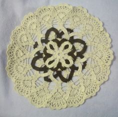 This beautiful doily is hand crocheted with cotton thread. It measures about 10 inches.  Machine wash/dry. When received it may require slight pressing due to folding for shipment, however it is press