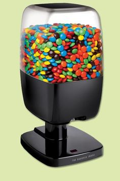Simply wave your hand for candy on demand. Great for home, the office, or anywhere you need a quick sweet fix. | @sharperonline Candy Dispenser from @overstock