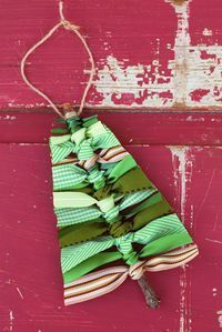 Use sticks and scraps of green ribbon to make this rustic Scrap Ribbon Tree Ornament. It's the perfect homemade Christmas ornament for kids!