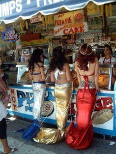 Mermaids getting a snack (Coney island mermaid parade)
