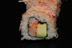 American Sushi Roll: Spicy Shrimp with Avocado with Spicy Crab on Top