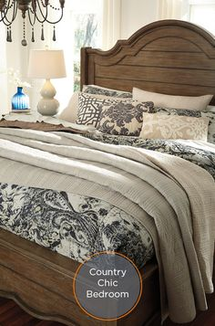 Create a chic country inspired bedroom with neutral black and white floral quilt.