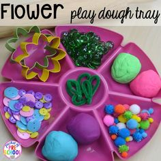 Flower play dough tray for a spring theme plus Plant Needs and Life Cycle Posters FREEBIE. Prefect for preschool, pre-k, and kindergarten.
