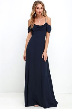 You'll be ready to take on the evening when you're outfitted in the Reflective Radiance Navy Blue Maxi Dress! Adjustable spaghetti straps support a draping Georgette bodice with elegant off-the-shoulder sleeves. Flattering fitted waist introduces the full maxi skirt. Hidden back zipper with clasp.