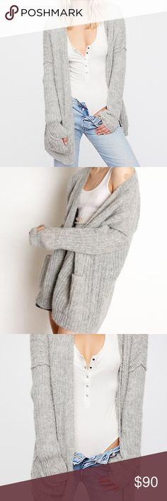 FREE PEOPLE WEEKEND GETAWAY CARDIGAN 87% alpaca , 17% nylon Dry clean only Open front Knit fabric Front patch pockets Manufacturer Style No. OB672971 Free People Sweaters Cardigans