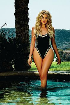 Showing off the results: In another image the 31-year-old wears the Norma Kamali 'Marissa' bodysuit as she wades in shallow water