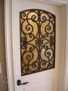 Faux Wrought Iron Door Insert @ Home Improvement Ideas--maybe for the pantry door in the kitchen.