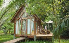 Home plans bungalow small cottages 54 ideas Bamboo House Design, Tiny House Design, Cottage In The Woods, House In The Woods, Hut House, Jungle House, House On Stilts, House In Nature, Small Cottages