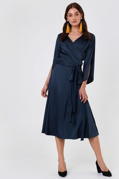 The Fab Wrap Long Dress by Rut&Circle features long sleeves with slits, a wrap design, and a self-tie around the waist.