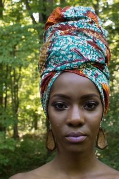 """Wearing wrapped African fabrics, on my head, as an accessory, that's naturally me. Sometimes, if I have enough fabric, I'll wrap & drape the fabric around my body. I tied and tucked the end of wrapping, at my breast.""~~Lady Zenobia™"