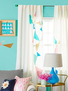 From All Angles -- Plain curtain panels require no more than stitched-on triangles in various hues of satin to become eye-catching. Select a few fabrics in coordinating colors and patterns. Cut out triangles in various sizes, and sew the shapes in a free-flowing pattern.
