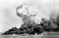 Pacific War - The explosion of an oil storage tank and clouds of smoke from other tanks, hit during the first Japanese air raid on Australia's mainland, at Darwin on 19 February In the foreground is HMAS Deloraine, which escaped damage. Pearl Harbor, Darwin Australia, Western Australia, Royal Australian Air Force, Air Raid, History Online, World War One, Military History, Wwii