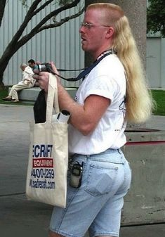 This superb jean short/hip phone/mullet combo. | The 31 Most Important Mullets That Ever Existed