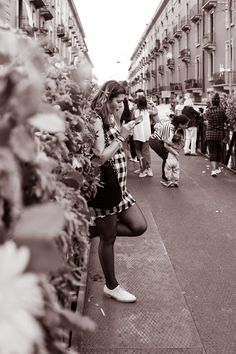 Resting on Flowers - A girl waiting for something or someone leaning herself a flowers little wall.