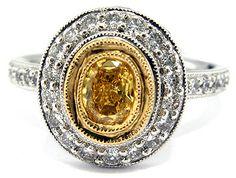 Fancy vintage oval yellow diamond engagement
