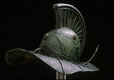 """A bronze, fully intact, undamaged Gladiator helmet featuring the hero Hercules on the front and the Nemian Lion, who he defeated, on the base of the comb. Rare. In the collection """"Warriors of the Ancient World"""" at the Higgins Armory Museum."""