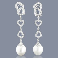 These fabulous Diamond Heart Pearl Earrings showcase 2 carats of sparkling round diamonds and 2 lustrous pearls. Featuring a lovely heart design, these ladies drop earrings with pearls are available in white, yellow and rose gold. Diamond Earrings For Women, Pearl And Diamond Earrings, Pearl Diamond, Diamond Heart, Pearl Jewelry, Diamond Jewelry, Heart Shaped Earrings, Jewelry Trends, Women's Earrings