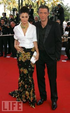 Men's Shirt, Shapely Skirt: 2006  Bellucci with Vincent Cassel at the premiere of Indigenes.