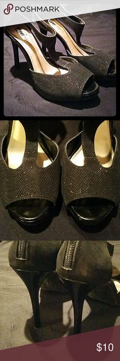 Black sparkle platform heels Black patent stem heel, black glitter fabric that covers the platform. Peep toe. T-strap up the foot and ankle strap. Zips up the back. Glitter in fabric so it won't shed. Worn once. Shoes Heels