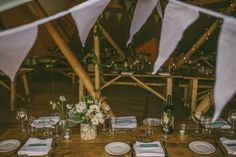 White Flowers, Bunting, Hanging Paper Lanterns & Giant Balloons Wedding Decor | Outdoor Ceremony in a Field | Aisle leading to a Characteristic Tree Altar | Tipi Reception | White Colour Scheme | Image by Antony Turner Photographer | http://www.rockmywedding.co.uk/joanna-paul/