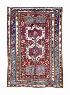 A FACHRALO KAZAK RUG -   SOUTH CAUCASUS, CIRCA 1900 -   Light localised wear, corroded brown, rewoven along either end  7ft. x 4ft.10in. (213cm. x 146cm.)