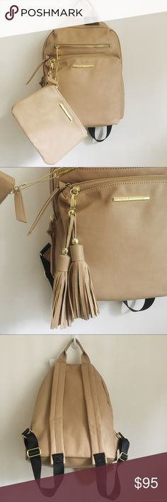 Steve Madden Backpack Brand new with tags Steve Madden Backpack. The backpack and pouch are in perfect condition having never been worn. The color is taupe; it's a smooth peanut color. 100% Authentic.                                                                 ❌NO TRADES❌                                                                                                           ❌All negotiations must be done using the offer button.❌ Steve Madden Bags Backpacks